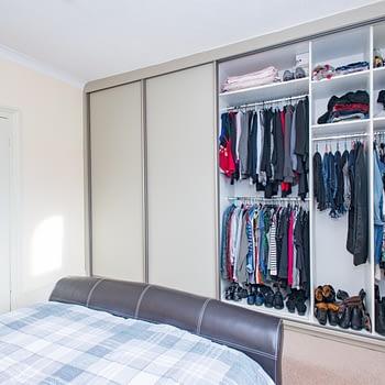 Custom sliding door wardrobes, door frame Niagara, colour champagne with Dakar satin glass panels, showing internals