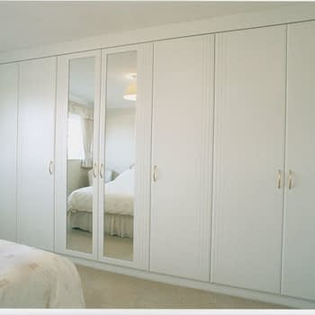 bespoke fitted wardrobe with mirrored feature doors colour white style geneva