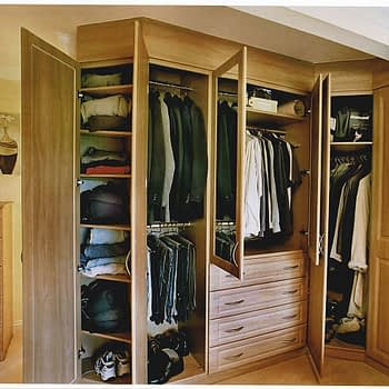 Open Oak wood wardrobe with angled end shelves double hanging short hanging with shelf and drawers below corner wardrobe