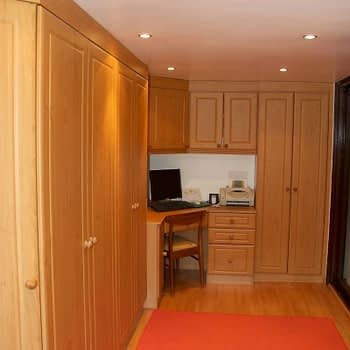 Fitted wardrobe with integrated corner desk bridge and angled end wardrobe colour milano cherry style kendall pi