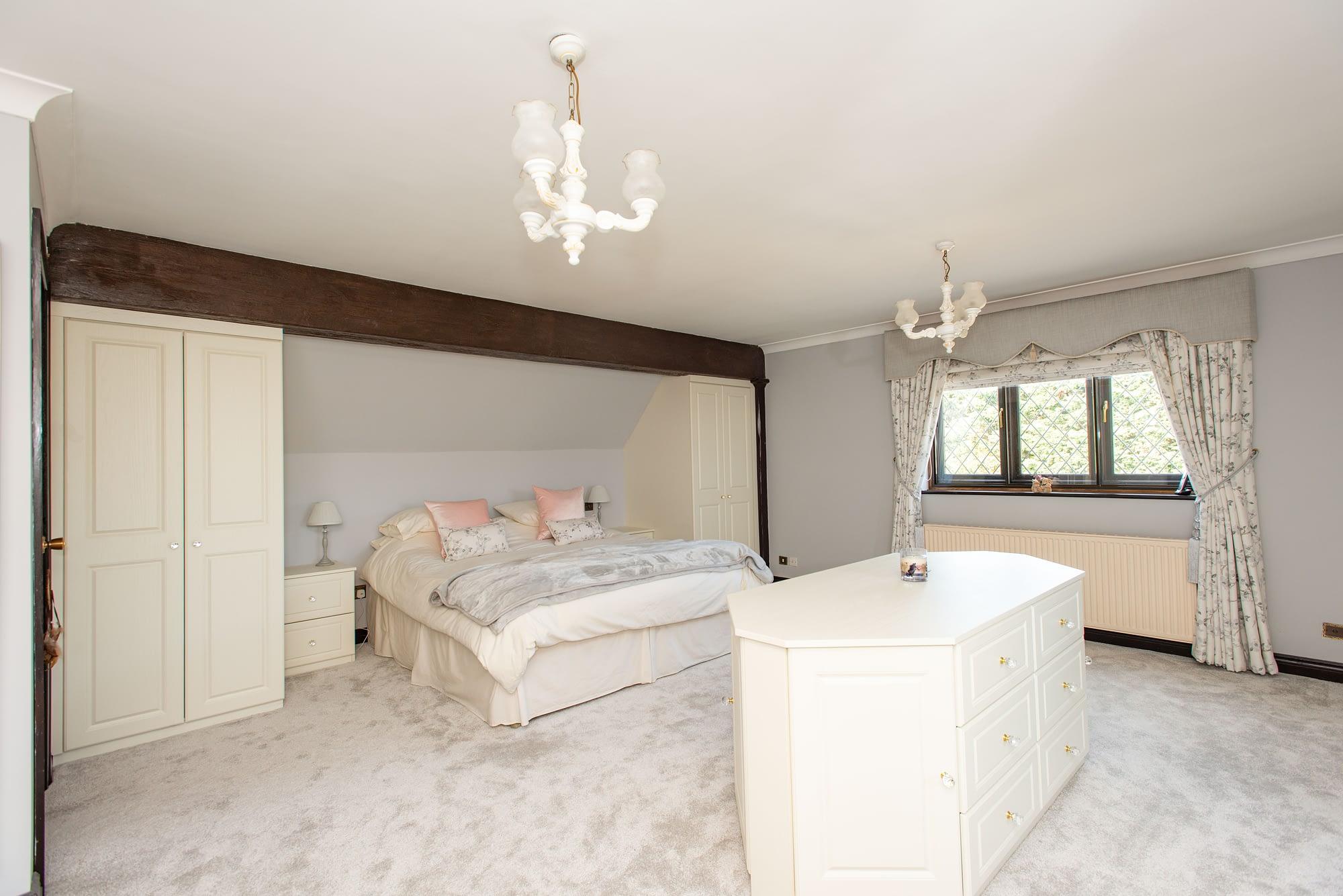 Custom bedroom furniture incorporating central island