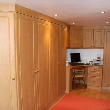 Fitted wardrobe with integrated corner desk bridge and angled end wardrobe colour milano cherry style kendall