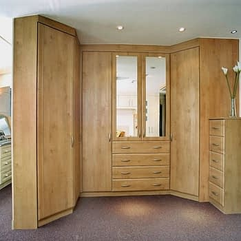 Bespoke bedroom with angled end wardrobe mirrored doors integral drawers and corner wardrobe colour celtic birch style sherwood