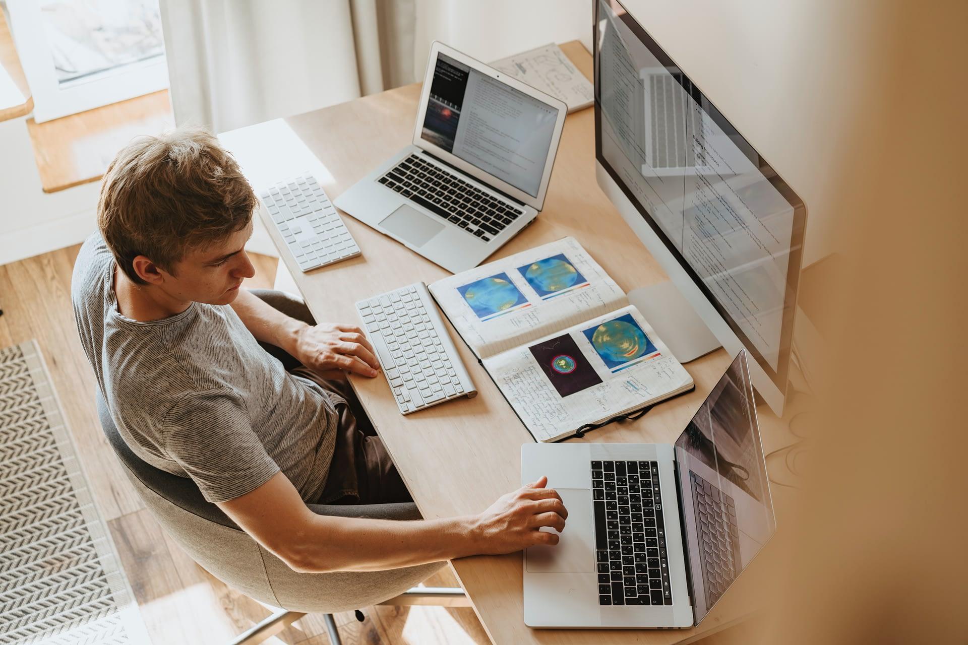man sitting a desk
