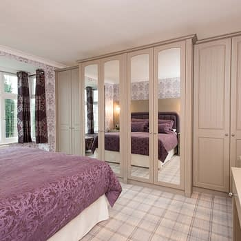 Custom fitted wardrobe with break front mirrors and pillasters colour stone grey style cottage arched