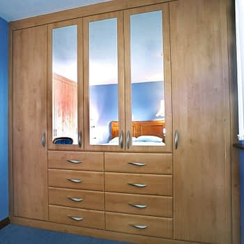 Custom built fitted wardrobe with mirrored doors and integral drawers colour celtic birch style sherwood