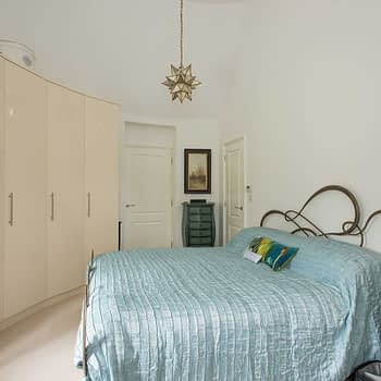 Custom fitted wardrobes for curved walls