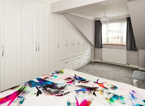 bespoke bedroom with angled ceiling