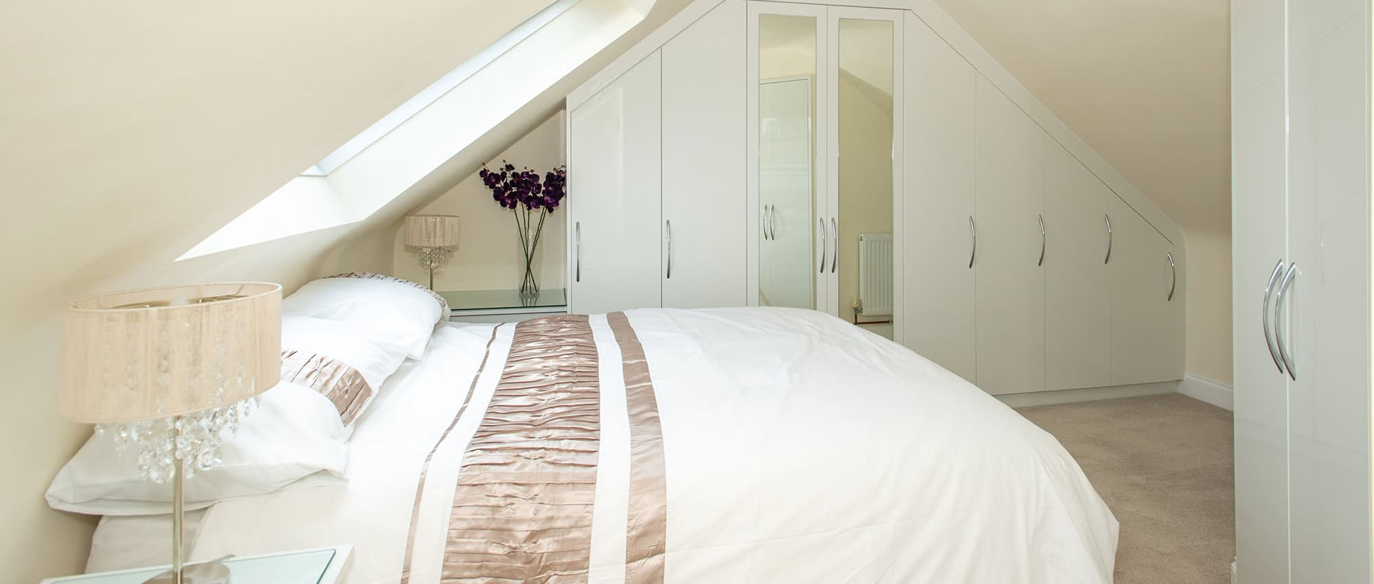 fitted wardrobes with angled ceiling