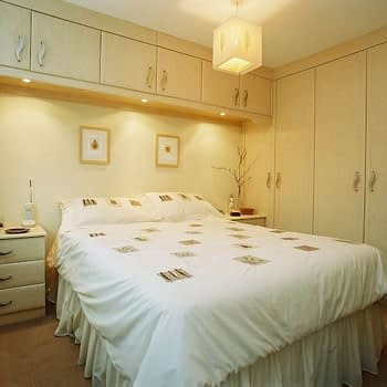 Custom fitted wardrobe with bridge bridge lights and bedside units colour maple style sherwood pic 2