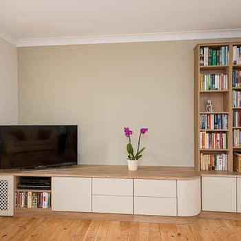 custom fitted living room furniture with rounded worktops and open bookshelves colour odessa oak and mussel style duleek