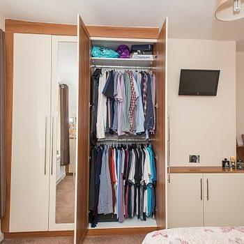 Bedroom wardrobe with double handing and shelf