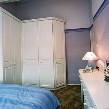 custom fitted bedroom with angled end wardrobe