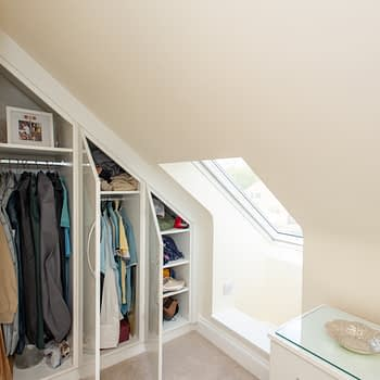 Fitted wardrobes to angled ceilings showing internals, colour white gloss, style Capri