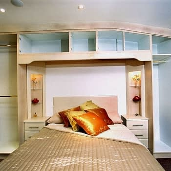 Bedroom with fitted wardrobes over bed