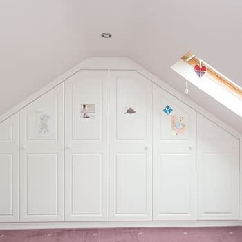 Custom fitted wardrobes for angled ceiling