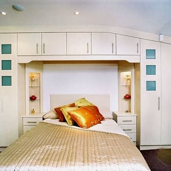 fitted wardrobe to angled ceiling with bedside units bridge and alcoves colour roxan birch style waverley with square portholes