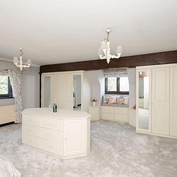 Custom bedroom furniture incorporating central island mirrored doors