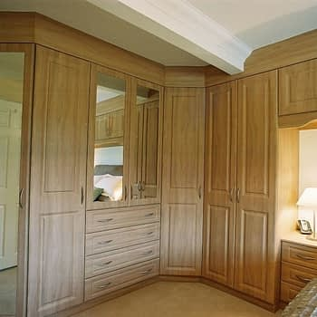 Made to measure angled wardrobe fitted around beam